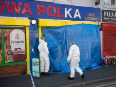 Forensic officers enter a shop on Waterloo Road after a teenager was fatally stabbed (PA)