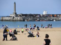 People enjoying the Spring sunshine in Margate, Kent (Kirsty O'Connor/PA)