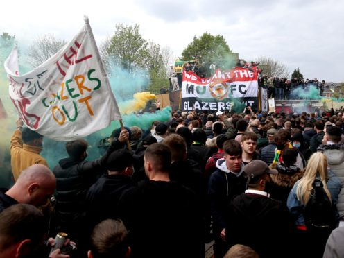 Fans protested outside the ground and some made it inside (Barrington Coombs/PA)