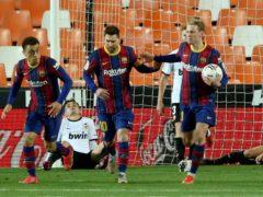 Barcelona's Lionel Messi celebrates scoring his side's first goal (Alberto Saiz/AP)