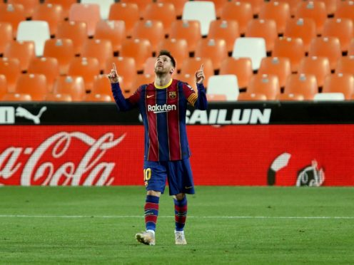 Barcelona's Lionel Messi celebrates scoring against Valencia (Alberto Saiz/AP).