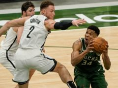 Milwaukee Bucks' Giannis Antetokounmpo, right, helped them to victory (Morry Gash/AP)