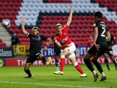 Jayden Stockley, centre, sets Charlton on their way to victory (Adam Davy/PA)