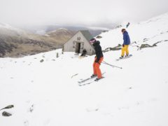 Skiers and snowboarders take to the slopes at the Lake District Ski Club on Raise, next to Helvellyn, after an unseasonal May snowfall (Owen Humphreys/PA)