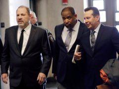 Harvey Weinstein, left, enters court with attorneys Ron Sullivan, center, and Jose Baez, in New York (Mark Lennihan/AP)