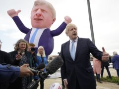 Boris Johnson stands near his inflatable likeness (Owen Humphreys/PA)
