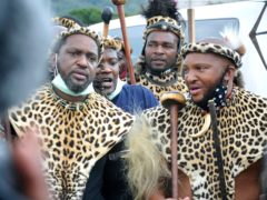 Prince Misuzulu Zulu, left, flanked by fellow warriors in traditional dress at the ceremony in KwaKhangelamankengane Royal Palace in Nongoma (AP)