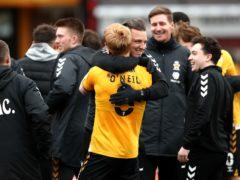 Cambridge manager Michael Bonner (centre) and Liam O'Neil celebrate (Tim Goode/PA)