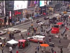 Pedestrians hurry away from the scene of a shooting in Times Square (FDNY via AP)