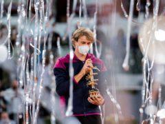 Alexander Zverev celebrates with the Madrid Open trophy (Bernat Armangue/AP)