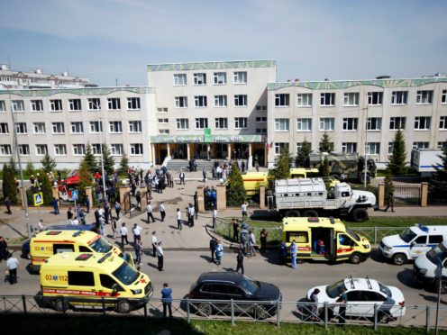 Ambulances and police cars at a school after a shooting in Kazan, Russia (Roman Kruchinin/AP)
