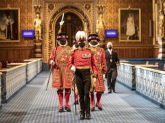 Masked Yeoman Warders march along the Royal Gallery during the ceremonial search of the Palace of Westminster ahead of the State Opening of Parliament by the Queen (Richard Pohle/The Times)