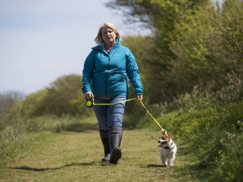 An actress playing the role of PCSO Julia James walks her Jack Russell dog Toby (Kirsty O'Connor/PA)