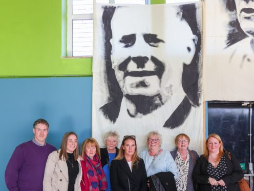 The family of John McKerr, including his daughter, Anne Ferguson (third from right), who spoke at the event, involving families of people who were killed at Ballymurphy, at Corpus Christi Youth Centre in Belfast. Coroner Mrs Siobhan Keegan attributed nine of the ten shootings at Ballymurphy to the British Army and said the use of lethal force by soldiers was not justified (Liam McBurney/PA Wire)
