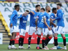 Rangers' Ryan Kent (second left) celebrates scoring their second goal of the game with teammates during the Scottish Premiership match at the Tony Macaroni Arena, Livingston. Picture date: Wednesday May 12, 2021.