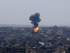 Smoke rises following Israeli airstrikes on a building in Gaza City (Hatem Moussa/AP)