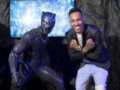 Black Panther is the latest superhero to be given the waxwork treatment at Madame Tussauds in London, and the figure was unveiled with the help of Pierre-Emerick Aubameyang (Ian West/PA)