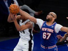 New York Knicks' Taj Gibson (67) steals the ball from San Antonio Spurs' Devin Vassell during the Knicks' win on Thursday night (Frank Franklin II/AP)