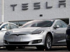 A Tesla 2018 Model 3 outside a Tesla showroom in the US (David Zalubowsi/PA) File)