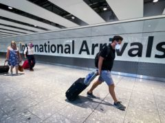 Passengers in the arrivals hall at Heathrow (Aaron Chown/PA)