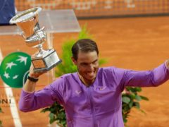Rafael Nadal celebrates with the trophy after winning his 10th Italian Open title in Rome (Gregorio Borgia/AP)