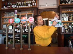 Staff at the The Carlton Tavern in Maida Vale, London, get ready for the pub to open (PA)