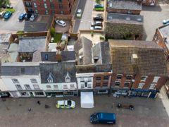 """Police activity at The Clean Plate cafe in Southgate Street, Gloucester where excavation work is to begin after police found """"possible evidence"""" of where Mary Bastholm, a suspected teenage victim of serial killer Fred West may be buried. Picture date: Tuesday May 18, 2021."""