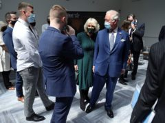 The Prince of Wales and the Duchess of Cornwall during a visit to the Education Authority Headquarters in Belfast (Clodagh Kilcoyne/PA)