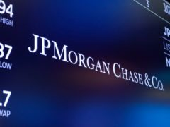 The logo for JPMorgan Chase & Co. appears above a trading post on the floor of the New York Stock Exchange (Richard Drew/AP)
