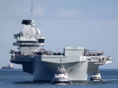 HMS Queen Elizabeth arrives back at Portsmouth Naval Base (Andrew Matthews/PA)