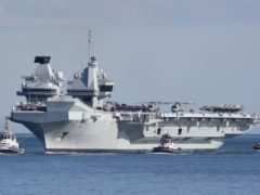 The Royal Navy aircraft carrier HMS Queen Elizabeth arrives back at Portsmouth Naval Base (Andrew Matthews/PA)