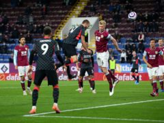 Nathaniel Phillips, centre left, scores Liverpool's second goal against Burnley at Turf Moor (Alex Livesey/PA)