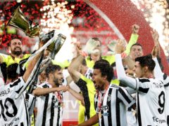 Juventus players celebrate after their victory against Atalanta in the Coppa Italia final (Antonio Calanni/AP)