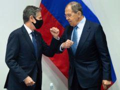 US secretary of state Antony Blinken, left, greets Russian foreign minister Sergey Lavrov (Saul Loeb/Pool Photo via AP)