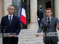Nato chief Jens Stoltenberg with Emmanuel Macron, president of France (Francois Mori/AP)