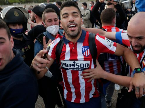 Atletico Madrid's Luis Suarez celebrates with supporters after clinching the LaLiga title (AP/Manu Fernandez)
