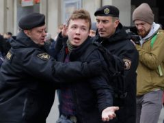 Raman Pratasevich is arrested during an earlier protest (AP)