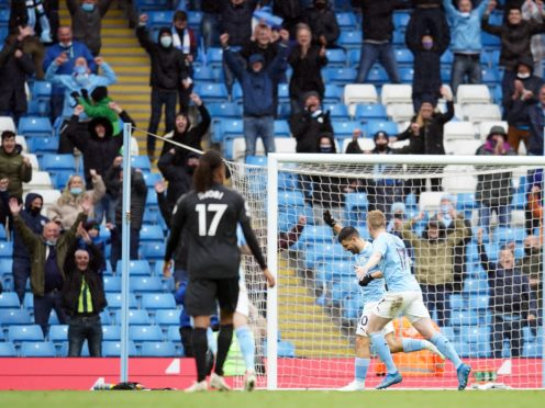 Manchester City fans celebrate after Sergio Aguero finds the net in his farewell appearance against Everton (Dave Thompson/PA)