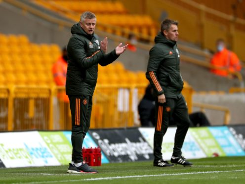 Manchester United manager Ole Gunnar Solskjaer, left, saluted his youngsters against Wolves (Bradley Collyer/PA)