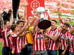 Kieran Trippier celebrates with the LaLiga title (Manu Fernandez/AP)