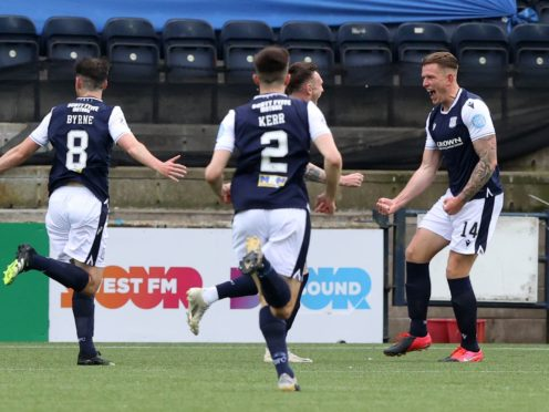 Lee Ashcroft, right, scored as Dundee beat his former club Kilmarnock to win promotion (Jeff Holmes/PA)