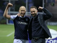 Dundee manager James McPake, right, and Charlie Adam, left, celebrate winning promotion (Jeff Holmes/PA)