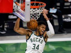 Milwaukee Bucks forward Giannis Antetokounmpo scores a slam dunk in his side's win over the Miami Heat (Jeffrey Phelps/AP)