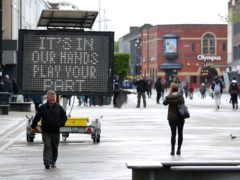 An electronic notice board in Bolton town centre, one of the areas of the UK where the Covid variant first identified in India is spreading fastest (Peter Byrne/PA)