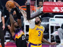 Phoenix Suns centre Deandre Ayton dunks against Los Angeles Lakers forward Anthony Davis (Ross Franklin/AP)