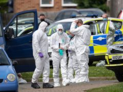 Police and forensic officers at the scene in Constable Road, Corby (Joe Giddens/PA)
