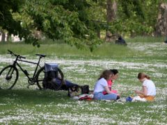 People enjoy the sunshine in St James's Park, London (Gareth Fuller/PA)
