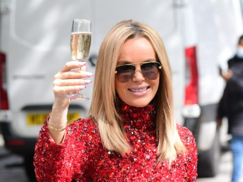 Radio presenter Amanda Holden at the launch of Heart Radio's 'Make Me a Millionaire' competition, outside the Global Radio studios in Leicester Square, central London. Picture date: Friday May 28, 2021.