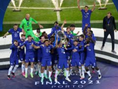 Chelsea's players celebrate with the Champions League trophy