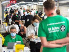 Staff and volunteers at work at a coronavirus vaccination centre at Twickenham (Dominic Lipinski/PA)